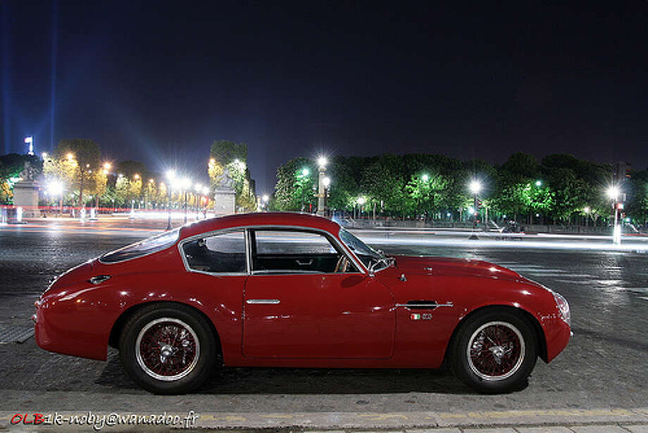 38. Aston Martin DB4 (1958–1963) What Popular Mechanics said: The DB4 was a true driver's car, with a 240-hp 3.7-liter six-cylinder engine, four-wheel disc brakes, and communicative handling. Its high-power Vantage and GT Zagato variants were too.(Photo: Eddy Clio, Flickr)Source: Popular Mechanics Photo: Flickr