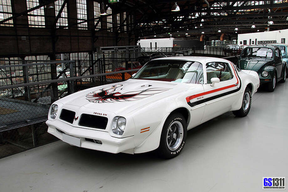 36. Pontiac Firebird Trans-Am (1970–1981) What Popular Mechanics said: The second generation Trans-Am rePresented a new era of muscle cars. The 1977 example is still famous for its role in Smokey and the Bandit . That, and the large bird painted on its hood. (Photo: George Schwalbach, Flickr)Source: Popular Mechanics Photo: Flickr
