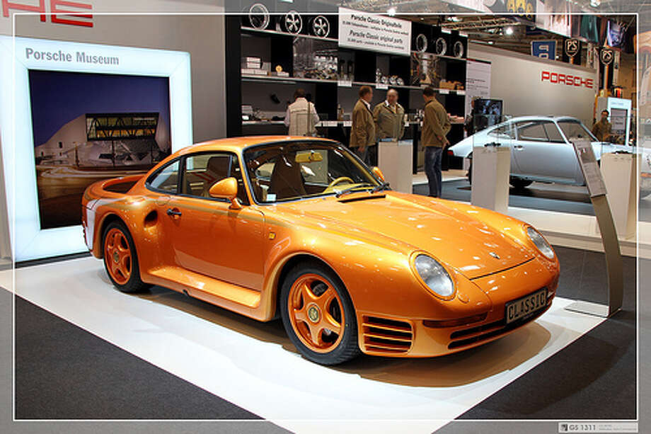 35. Porsche 959 (1986–1989) What Popular Mechanics said: An automotive icon of the'80s, the 959 featured ground-breaking technology from bumper to bumper, including a revolutionary all-wheel-drive system.(Photo: George Schwalbach, Flickr)Source: Popular Mechanics Photo: Flickr