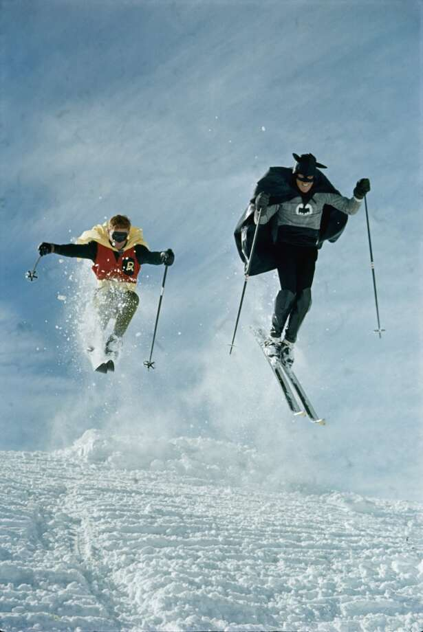 Hitting the slopes. (Actually this isn't Batman and Robin; it's a Vail ski instructor and patrol member racing down a mountain in 1966).