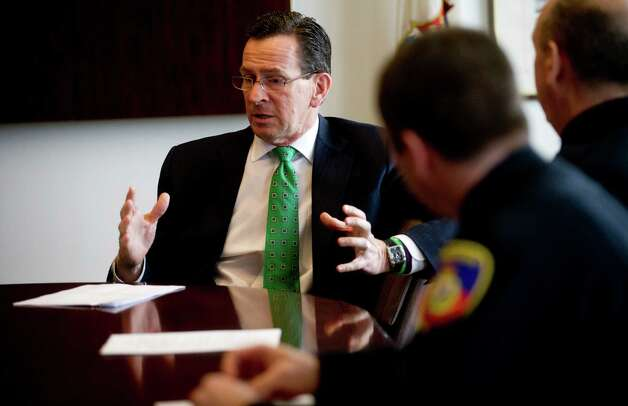 Connecticut Gov. Dannel P. Malloy meets with Stamford Mayor Michael Pavia, Director of Public Safety Ted Jankowski, and Police Chief Jonathan Fontneau at Government Center on Tuesday, February 26, 2013, to discuss Malloy's gun violence prevention plan. Photo: Lindsay Perry / Stamford Advocate