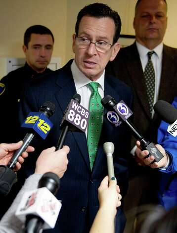 Connecticut Gov. Dannel P. Malloy speaks with the media after he met with Stamford Mayor Michael Pavia, Director of Public Safety Ted Jankowski, and Police Chief Jonathan Fontneau at Government Center on Tuesday, February 26, 2013, to discuss Malloy's gun violence prevention plan. Photo: Lindsay Perry / Stamford Advocate