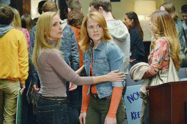 "In ""Switched at Birth,"" Katie Leclerc (center, as Daphne Vasquez) feels torn when the deaf students rally the school board to prevent even more hearing kids from attending. Leclerc, who has San Antonio roots, is seen with co-star Marlee Matlin. Photo: ABC Family / © 2013 Disney Enterprises, Inc. All rights reserved."