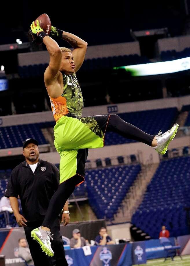 LSU defensive back Tyrann Mathieu makes a leaping catch. Photo: Dave Martin