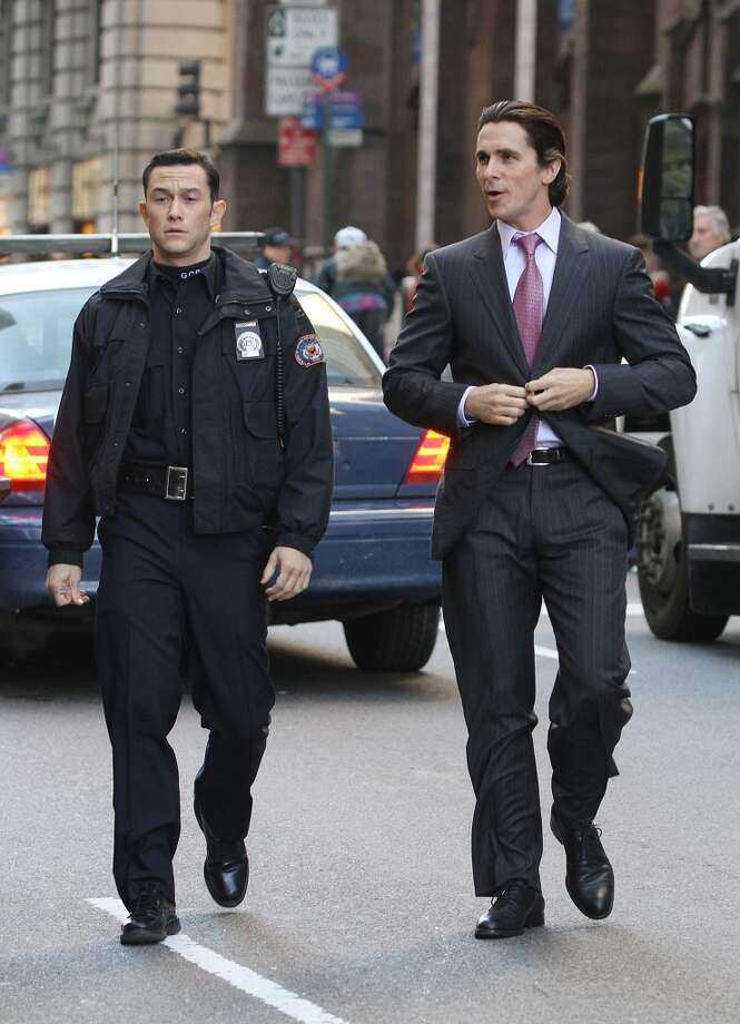 "Joseph Gordon-Levitt (left) played Robin to Christian Bale's Batman in 2012's ""The Dark Knight Rises."" But will Gordon-Levitt's character - police officer John Blake - turn into Batman?"