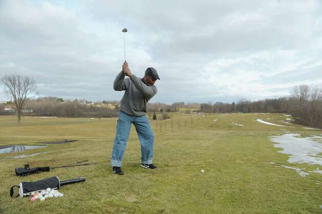 Johnny Bobo of Troy practices his golf driving at Frear Park on Tuesday, Feb. 26, 2013 in Troy, NY.  (Paul Buckowski / Times Union) Photo: Paul Buckowski