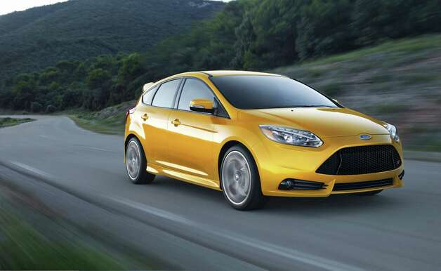 The 2013 Ford Focus ST has a 2-liter turbo EcoBoost four-cylinder that produces 252 horsepower and has a six-speed manual. Photo: Photos By Ford Motor Co.