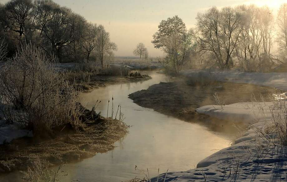 Steam risesfrom the Usiazha River on a frigid day near the Belarus village of Usiazha. Photo: Viktor Drachev, AFP/Getty Images
