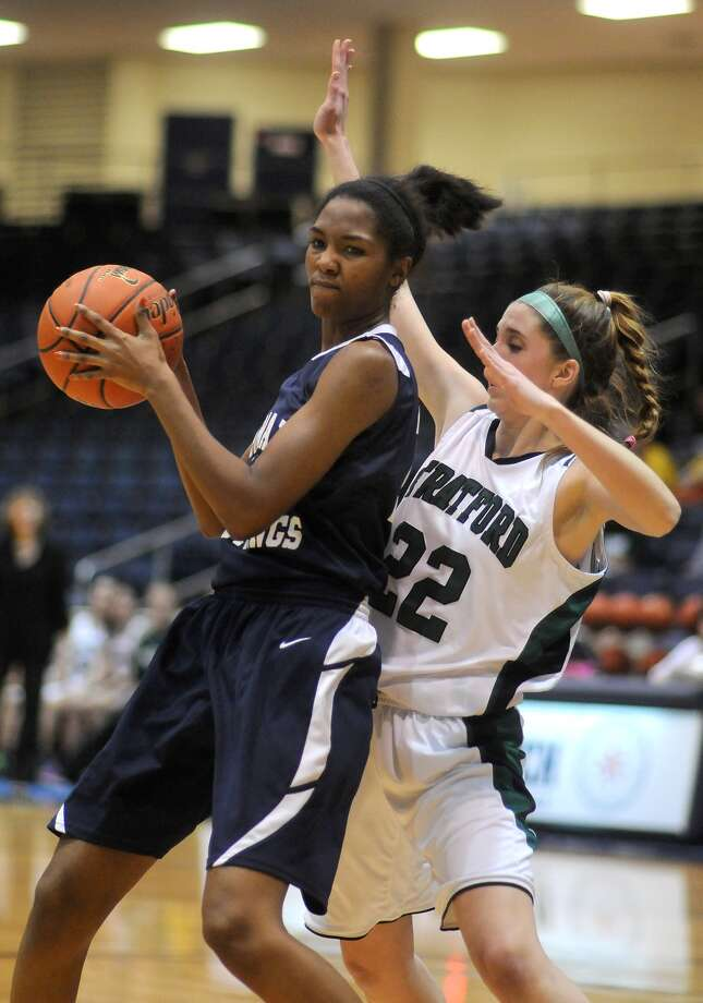Lamar Consolidated's Marleah Palmer, left, works against Stratford senior guard Jaime Hewitt (#22) during their Region III-4A playoff at the Coleman Coliseum. Freelance photo by Jerry Baker Photo: Jerry Baker, Freelance