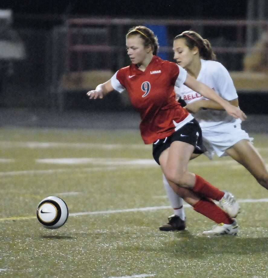 Lamar's Natalie Cohen (#9) advances the ball with Bellaire's Nina Buturovic (#10) at her back during their game at Butler Stadium Friday 2/22/13. Photo  by Tony Bullard. Photo:  Tony Bullard 2013, Freelance Photographer / © Tony Bullard & the Houston Chronicle