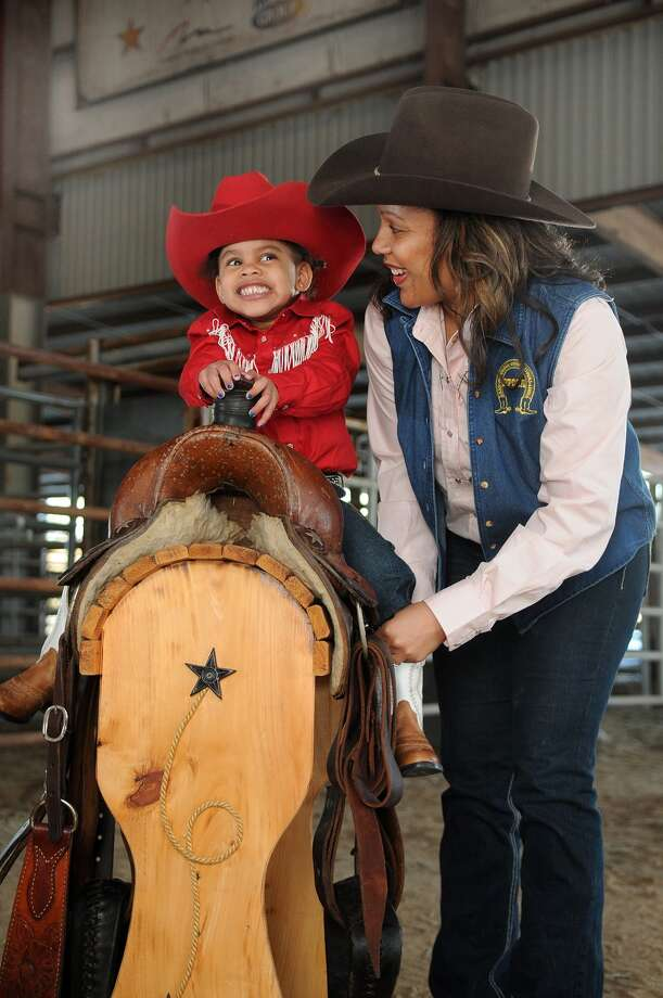 Taryn Hawkins, 2, and her mom, Dena, are all ready to join the Humble Heritage Day celebration March 2 at the Humble Civic Center. Photo: Jerry Baker, Freelance