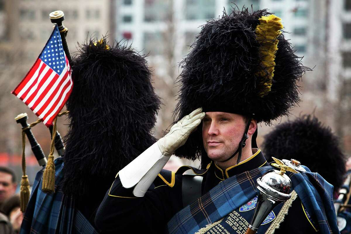 NEW YORK, NY - FEBRUARY 26: A member of the Port Authority Pipes and Drums band stands at attention during the 20th Anniversary Ceremony for the 1993 World Trade Center bombing at Ground Zero on February 26, 2013 in New York City. The attack, which utilized a car bomb and hit the north tower, killed six people.