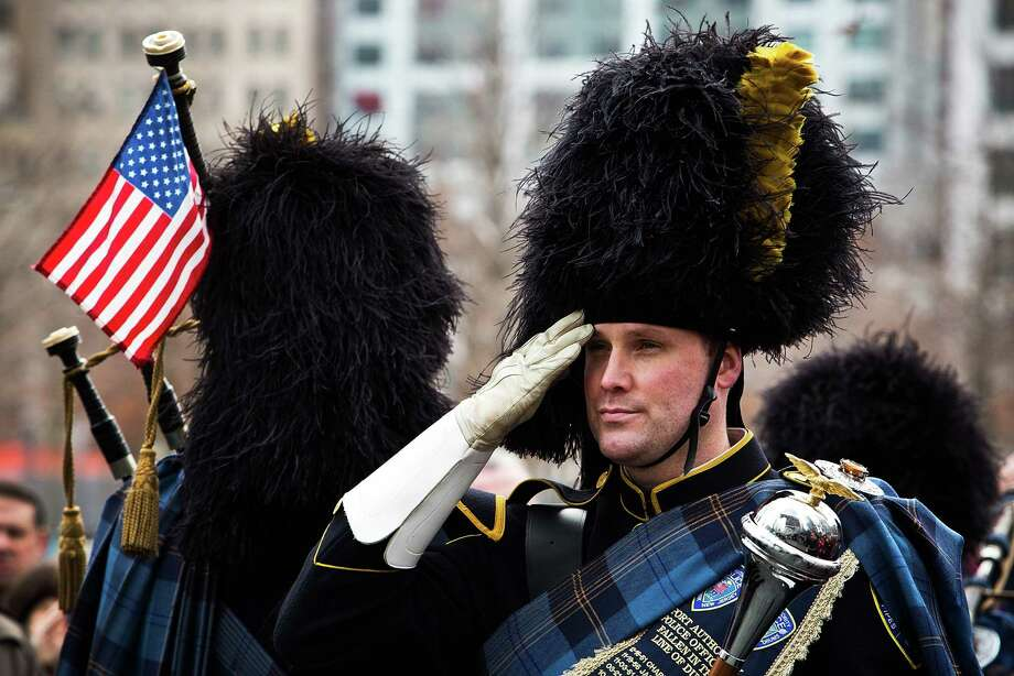 NEW YORK, NY - FEBRUARY 26:  A member of the Port Authority Pipes and Drums band stands at attention during the 20th Anniversary Ceremony for the 1993 World Trade Center bombing at Ground Zero on February 26, 2013 in New York City. The attack, which utilized a car bomb and hit the north tower, killed six people. Photo: Andrew Burton, Getty Images / 2013 Getty Images