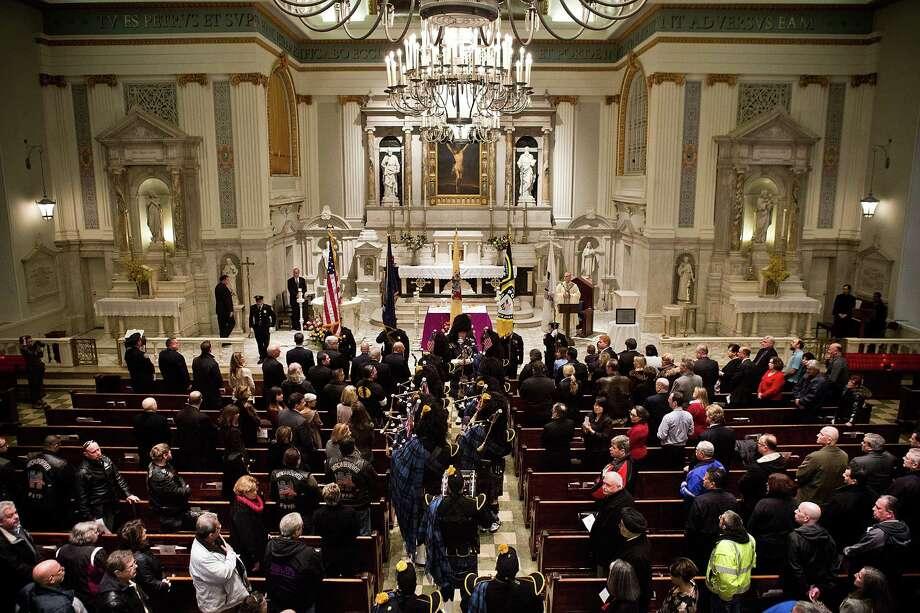 NEW YORK, NY - FEBRUARY 26:  Mourners attend mass at St. Patrick's Roman Catholic Church, prior to the 20th Anniversary Ceremony for the 1993 World Trade Center bombing at Ground Zero on February 26, 2013 in New York City. The attack, which utilized a car bomb and hit the north tower, killed six people. Photo: Andrew Burton, Getty Images / 2013 Getty Images