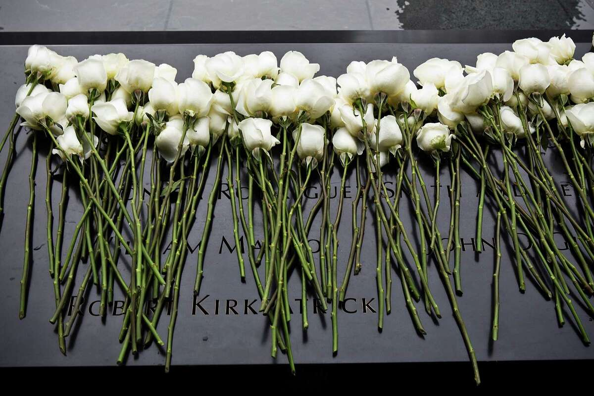 NEW YORK, NY - FEBRUARY 26: White roses lay at the memorial site after the 20th Anniversary Ceremony for the 1993 World Trade Center bombing at Ground Zero on February 26, 2013 in New York City. The attack, which utilized a car bomb and hit the north tower, killed six people.