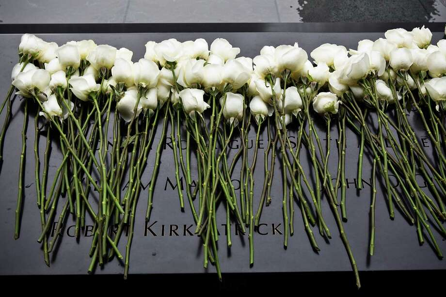 NEW YORK, NY - FEBRUARY 26:  White roses lay at the memorial site after the 20th Anniversary Ceremony for the 1993 World Trade Center bombing at Ground Zero on February 26, 2013 in New York City. The attack, which utilized a car bomb and hit the north tower, killed six people. Photo: Andrew Burton, Getty Images / 2013 Getty Images
