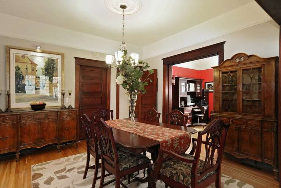 Dining room of 3612 N.E. 43rd St. The 1,880-square-foot Craftsman, built in 1909, has three bedrooms, 1.5 bathrooms, exposed wood moldings and doors, a foyer, walls of windows in the living room, a den, an office nook, a front porch and deck, a back deck and patio, and a two-car garage on a 5,000-square-foot lot. It's listed for $689,000, although a sale is pending. Photo: Courtesy Kristi Johnson/Windermere Real Estate
