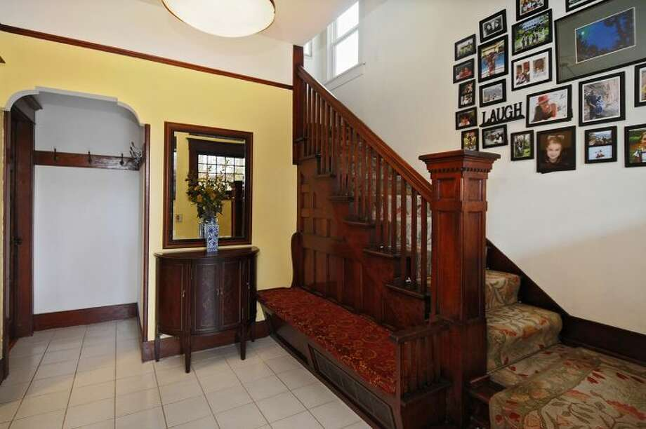 Foyer of 3612 N.E. 43rd St. The 1,880-square-foot Craftsman, built in 1909, has three bedrooms, 1.5 bathrooms, exposed wood moldings and doors, walls of windows in the living room, a den, an office nook, a front porch and deck, a back deck and patio, and a two-car garage on a 5,000-square-foot lot. It's listed for $689,000, although a sale is pending. Photo: Courtesy Kristi Johnson/Windermere Real Estate