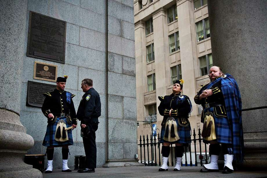 NEW YORK, NY - FEBRUARY 26:  Members of the Port Authority Pipes and Drums band wait outside during mass at St. Patrick's Roman Catholic Church, prior to the 20th Anniversary Ceremony for the 1993 World Trade Center bombing at Ground Zero on February 26, 2013 in New York City. The attack, which utilized a car bomb and hit the north tower, killed six people. Photo: Andrew Burton, Getty Images / 2013 Getty Images