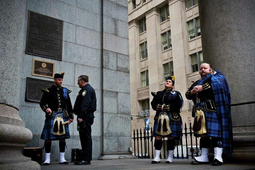 NEW YORK, NY - FEBRUARY 26:  Members of the Port Authority Pipes and Drums band wait outside during
