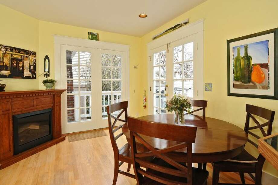 Breakfast area of 3612 N.E. 43rd St. The 1,880-square-foot Craftsman, built in 1909, has three bedrooms, 1.5 bathrooms, exposed wood moldings and doors, a foyer, walls of windows in the living room, a den, an office nook, a front porch and deck, a back deck and patio, and a two-car garage on a 5,000-square-foot lot. It's listed for $689,000, although a sale is pending. Photo: Courtesy Kristi Johnson/Windermere Real Estate