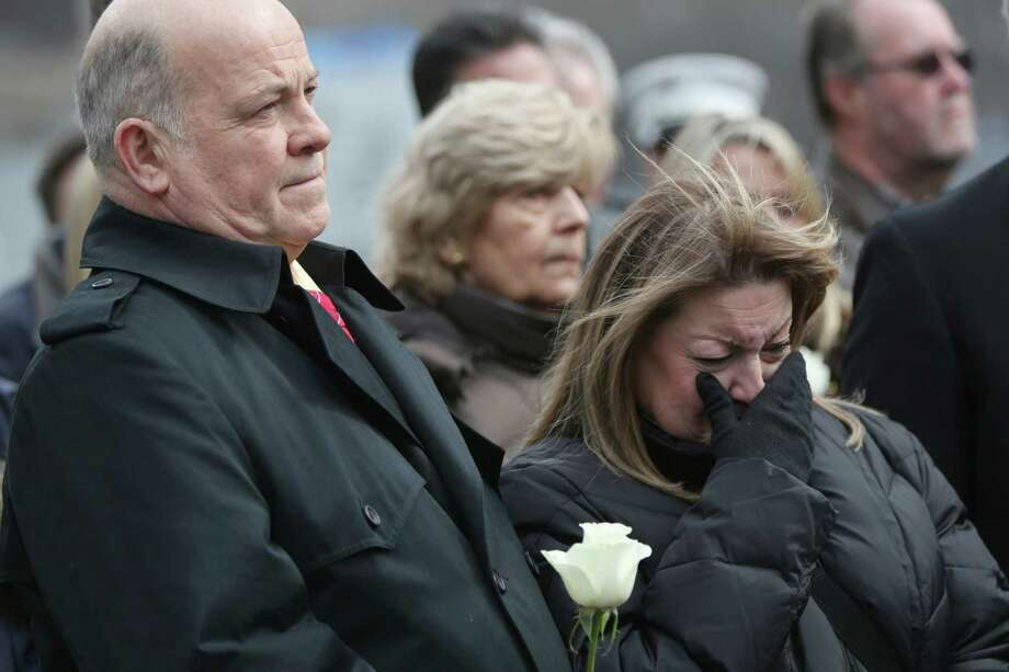 "Family members of the those killed in the first terrorist attack on the World Trade Center in New York observe a moment of silence Tuesday, Feb. 26, 2013, during a ceremony to honor the six people who died in the attack 20 years ago. The moment of silence was observed at 12:18 p.m., the time when a truck bomb was detonated below the north tower. The victims' names were read by family members before bagpipers played ""Amazing Grace."" About 50 people attended the ceremony, held at the 9/11 memorial, where the twin towers were destroyed eight years later. Photo: Mary Altaffer, AP / AP"