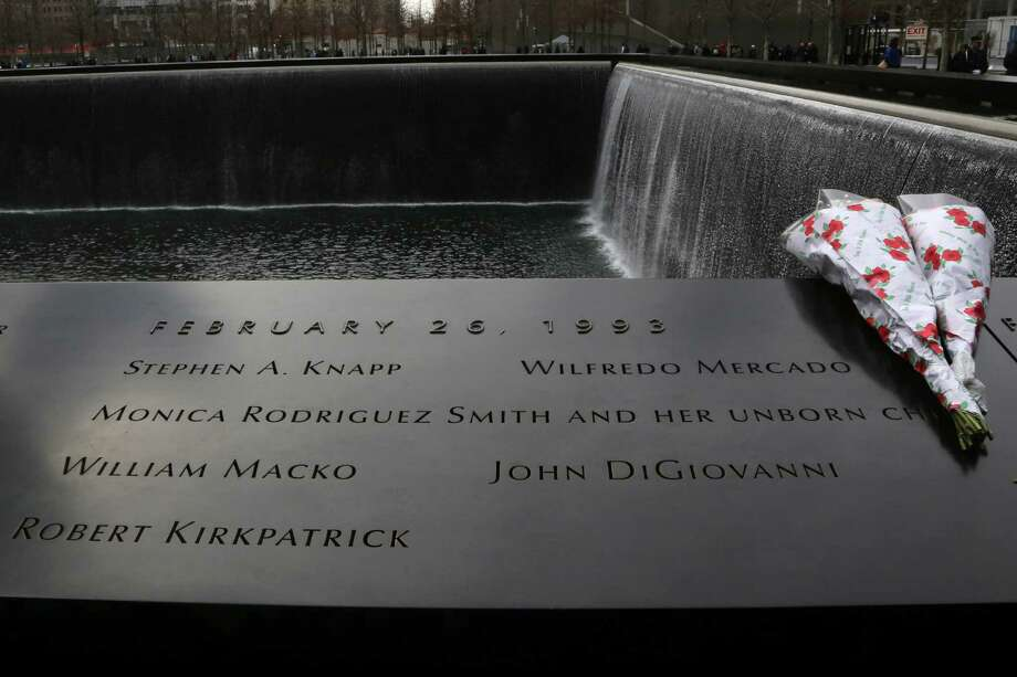 Flowers are placed near the names of the six people who were killed 20 years ago in the first terrorist attack on the World Trade Center in New York, before the start of a ceremony to remember them Tuesday, Feb. 26, 2013. About 50 people attended the ceremony, held at the 9/11 memorial, where the twin towers were destroyed eight years later. Photo: Mary Altaffer, AP / AP