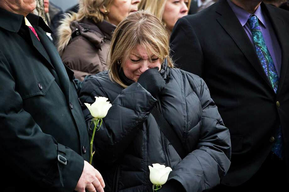NEW YORK, NY - FEBRUARY 26:  A woman cries while attending the 20th Anniversary ceremony for the 1993 World Trade Center bombing at Ground Zero on February 26, 2013 in New York City. The attack, which utilized a car bomb and hit the north tower, killed six people. Photo: Andrew Burton, Getty Images / 2013 Getty Images