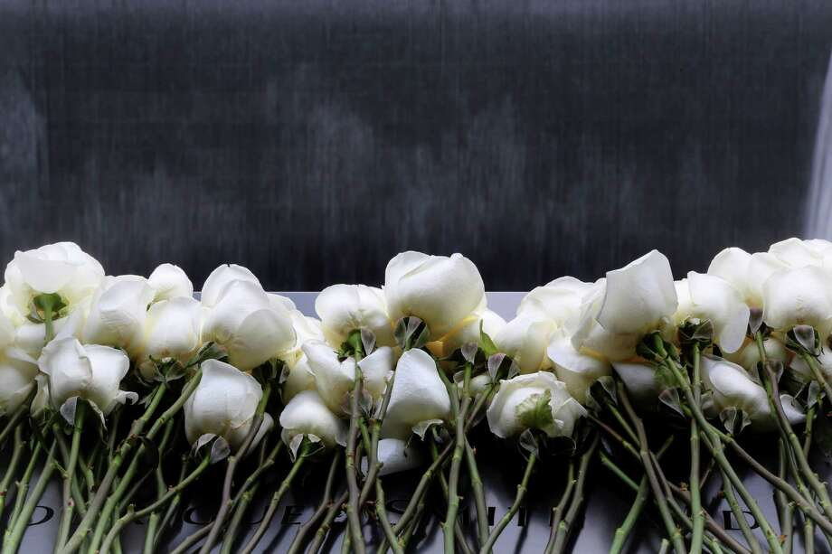 White roses are placed on the names of the six people who were killed 20 years ago in the first terrorist attack on the World Trade Center in New York, before the start of a ceremony to remember them Tuesday, Feb. 26, 2013. About 50 people attended the ceremony, held at the 9/11 memorial, where the twin towers were destroyed eight years later. Photo: Mary Altaffer, AP / AP