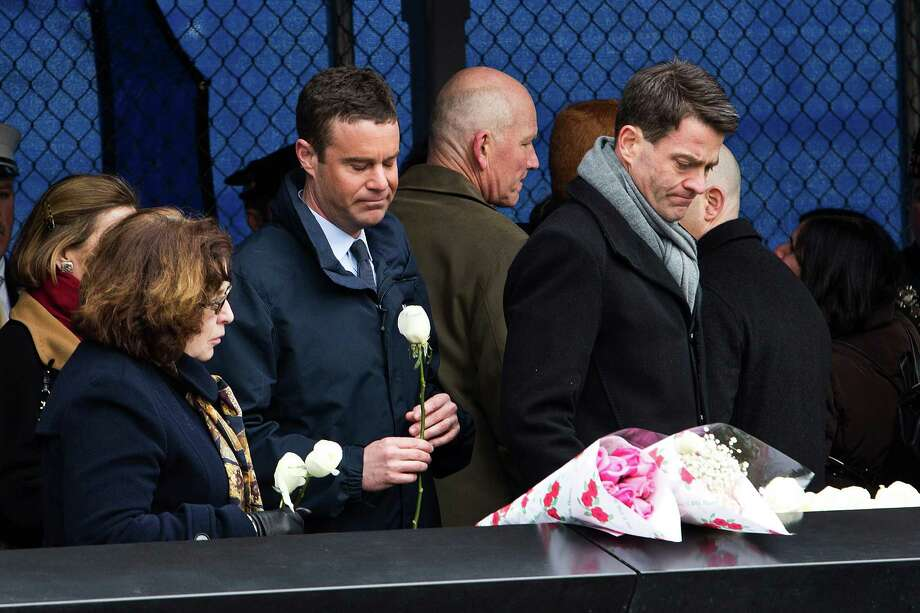 NEW YORK, NY - FEBRUARY 26:  Mourners lay white roses at the memorial site during the 20th Anniversary Ceremony for the 1993 World Trade Center bombing at Ground Zero on February 26, 2013 in New York City. The attack, which utilized a car bomb and hit the north tower, killed six people. Photo: Andrew Burton, Getty Images / 2013 Getty Images