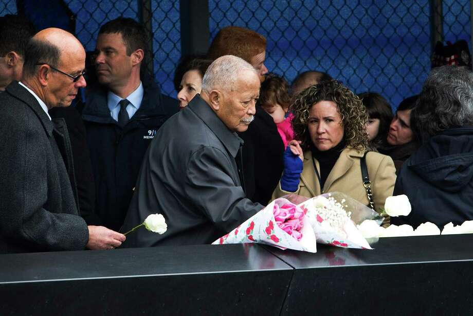 NEW YORK, NY - FEBRUARY 26:  Former New York City Mayor David Dinkins lays a white rose at the memorial site during the 20th Anniversary Ceremony for the 1993 World Trade Center bombing at Ground Zero on February 26, 2013 in New York City. The attack, which utilized a car bomb and hit the north tower, killed six people. Photo: Andrew Burton, Getty Images / 2013 Getty Images
