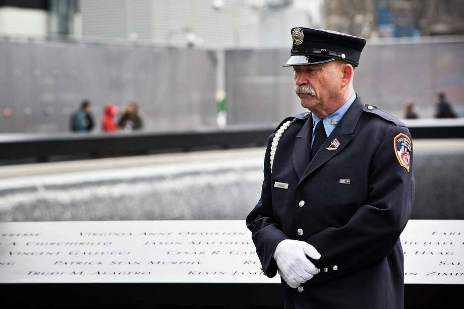 NEW YORK, NY - FEBRUARY 26:  A port authority officer stands before the 20th Anniversary Ceremony for the 1993 World Trade Center bombing at Ground Zero on February 26, 2013 in New York City. The attack, which utilized a car bomb and hit the north tower, killed six people. Photo: Andrew Burton, Getty Images / 2013 Getty Images