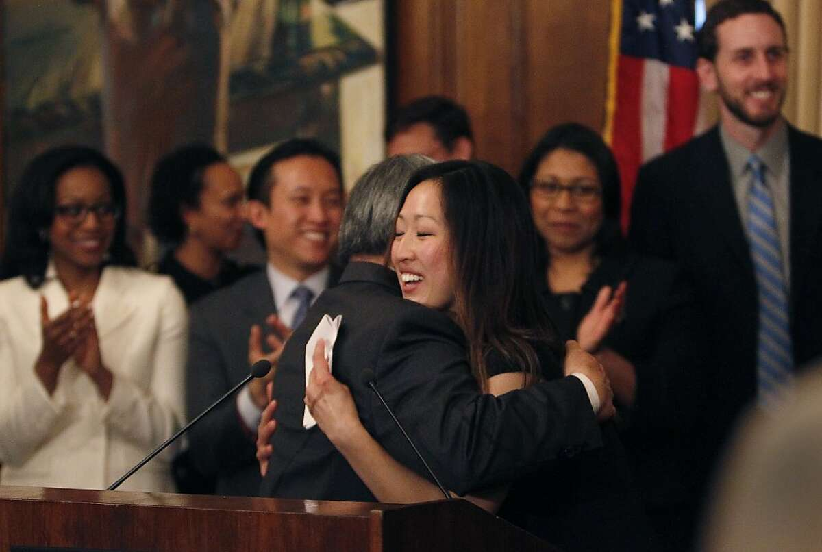 Katy Tang (right), legislative aide to outgoing Supervisor Carmen Chu, and Mayor Ed Lee (left) hug after Mayor Lee announced Tang as his pick to replace Chu as the District Four representative on the Board of Supervisors on Tuesday, February 26, 2013 in San Francisco, Calif.