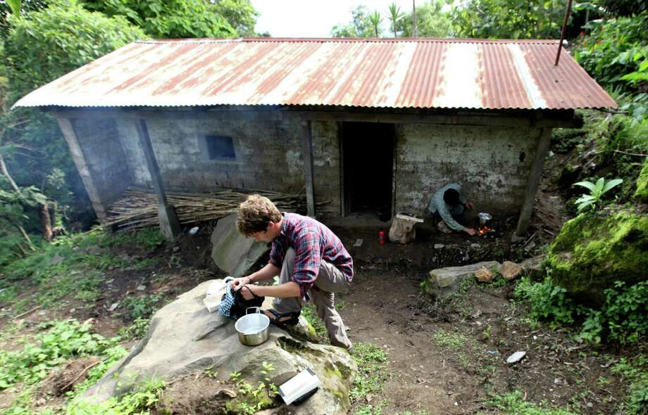 Chris Temple, a former Fairfielder, washes his clothes while living on a dollar a day in Guatemala during the summer of 2010. He and Zach Ingrasci, co-founders of the nonprofit Living on One, will share on the experience Wednesday, March 6, at Pequot Library. Photo: Contributed Photo