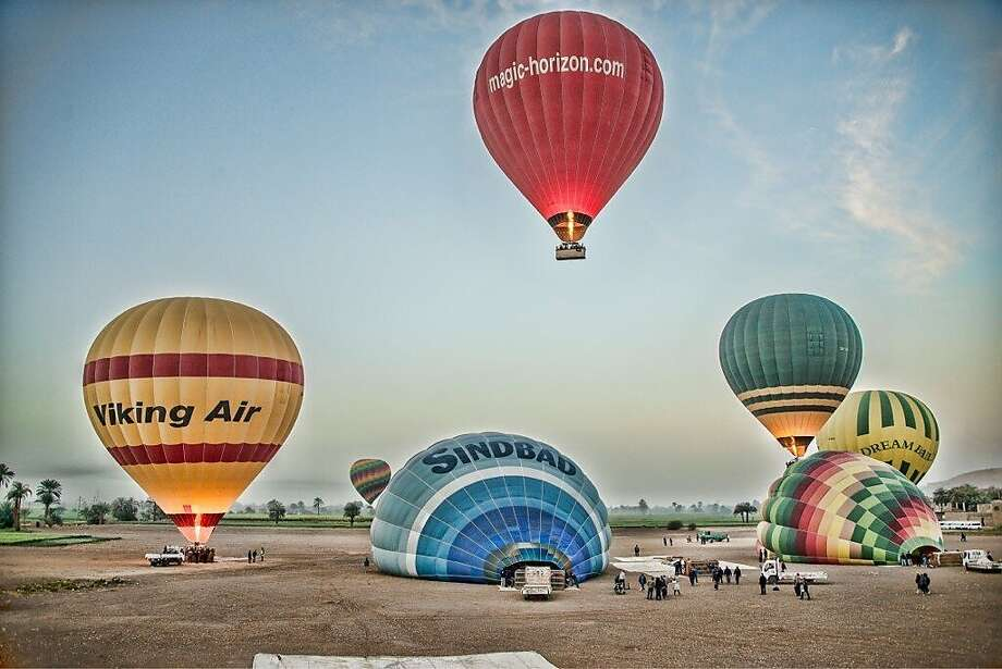 Hot-air balloons rise into the sky above Luxor, Egypt, where the rides are a popular tourist attraction. Another balloon crashed in what may be the deadliest such accident on record. Photo: Christopher Michel, Associated Press