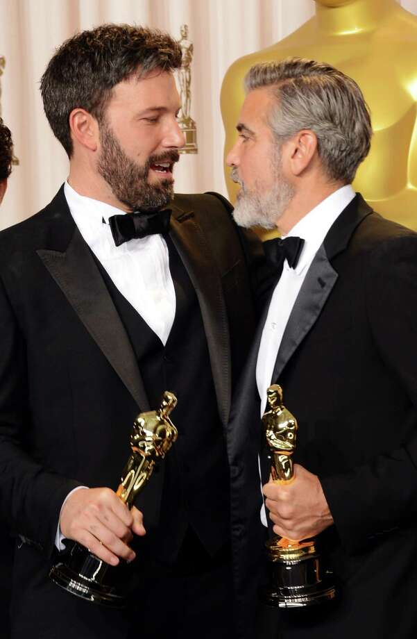 "HOLLYWOOD, CA - FEBRUARY 24:  Actor-producer-director Ben Affleck (L) and producer George Clooney, winners of the Best Picture award for ""Argo,"" pose in the press room during the Oscars held at Loews Hollywood Hotel on February 24, 2013 in Hollywood, California.  (Photo by Jason Merritt/Getty Images) Photo: Jason Merritt, Staff / 2013 Getty Images"