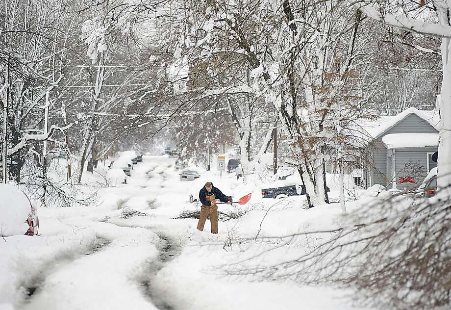 After the second major snowstorm in a week, Wes Anderson clears his grandparents' Sedalia, Mo., driveway. The storm was so severe that Missouri officials urged the public to avoid travel. Photo: Sydney Brink, Associated Press
