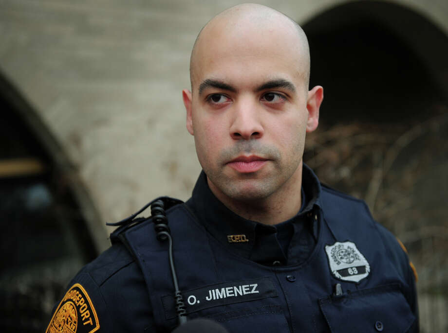 Bridgeport police Officer Omar Jimenez helped rescue a woman who fell into the water at Captain's Cove Seaport in Bridgeport on Monday night. Photo: Brian A. Pounds / Connecticut Post