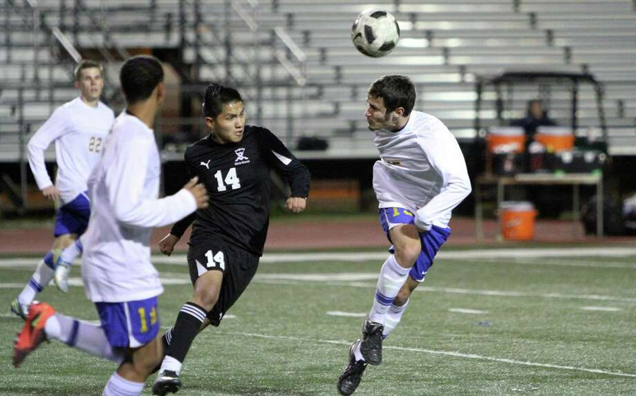 Clemens' Darren Valentin (15) heads the ball away from an attacking Seguin Matador Friday during second-half action in the Buffs' 2-0 home loss to Seguin. Photo: Greg Bell / For The NE Herald