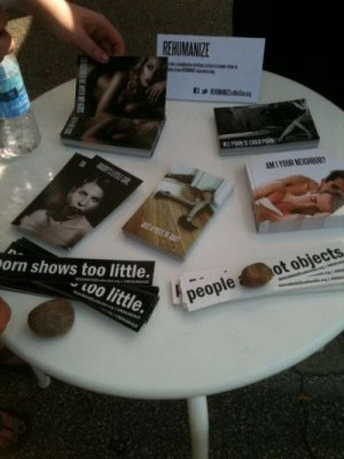 You can get a postcard to take home and visit rehumanizecollection.org. (Photo by Frankie Ortega) Photo: Houston Chronicle