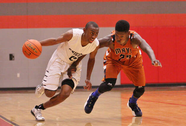 C.J. Siples dribbles past Madison's Ja'Michael Brown (23) en route to the basket during Steele's 61-58 second-round playoff win over the Mavericks. Siples led the Knights in scoring with 23 points. Photo: Miles Smith / For The NE Herald