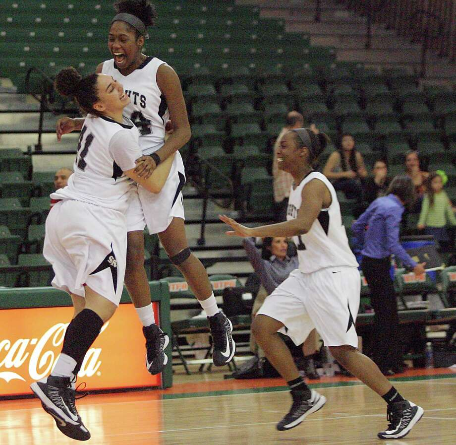 Steele's Bri Millett embraces an airborne McKenzie Calvert as the Lady Knights celebrate their Class 5A Region title Saturday after beating Wagner, 58-54, at the University of Texas Pan American Fieldhouse in Edinburg. Steele's Erika Chapman (right) joins in the celebration. Photo: Delcia Lopez / For The Express-News
