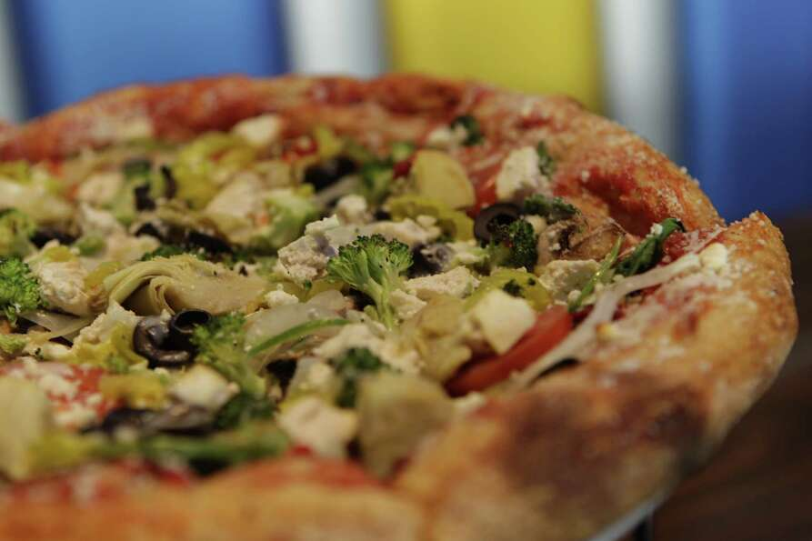 A Mega-Veggie pizza shown at Mellow Mushroom, 16000 Stuebner Airline Rd., Wednesday, Feb. 20, 2013,