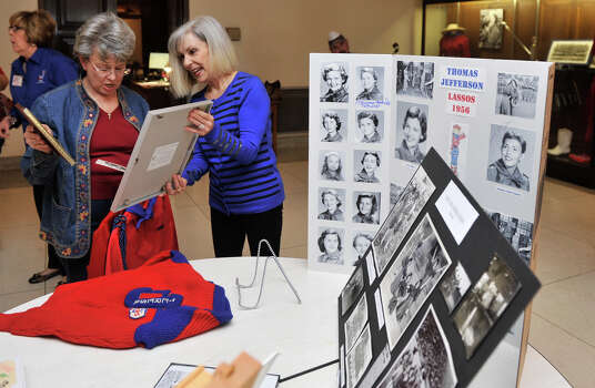 Vernell Johnson, a Thomas Jefferson Lasso from 1961 and Teresa O'Mara, a 1965 Lasso, look over memorabilia at a mixer with the current day Lasso's. Photo: Robin Jerstad