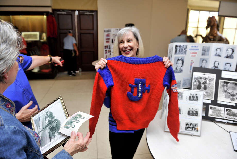 Teresa O'Mara (right) , a 1965 Lasso, laughs with friend and 1961 Lasso Vernell Johnson, saying that she can still wear her high school sweater. The two were attending a mixer at the school for alumni members of the Lasso's could meet the current day group. Photo: Robin Jerstad