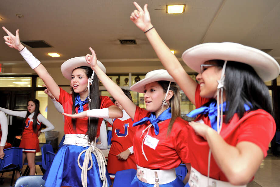 Thomas Jefferson High School Lasso's Angelica Rodriguez, Ruby Gonzalez, and Armanda Casaret sing the school song during a open a mixer with Lasso alumni. Photo: Robin Jerstad