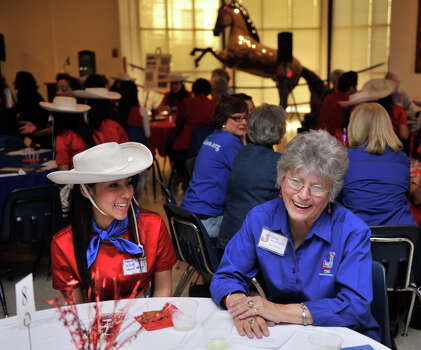 Thomas Jefferson High School Lasso Kayla Regalado (left) and 1858  Lasso alumni Patsy Long Skeels laugh during a mixer at the school. The Lasso's have been a fixture at the school for over 80 years. Photo: Robin Jerstad