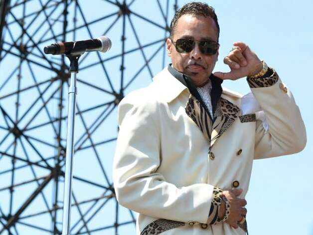 Please note: If your name is not Morris Day or The Time you are not cool enough to wear this suit outside, in the summer.  (Photo by Jay Dryden) Photo: Houston Chronicle
