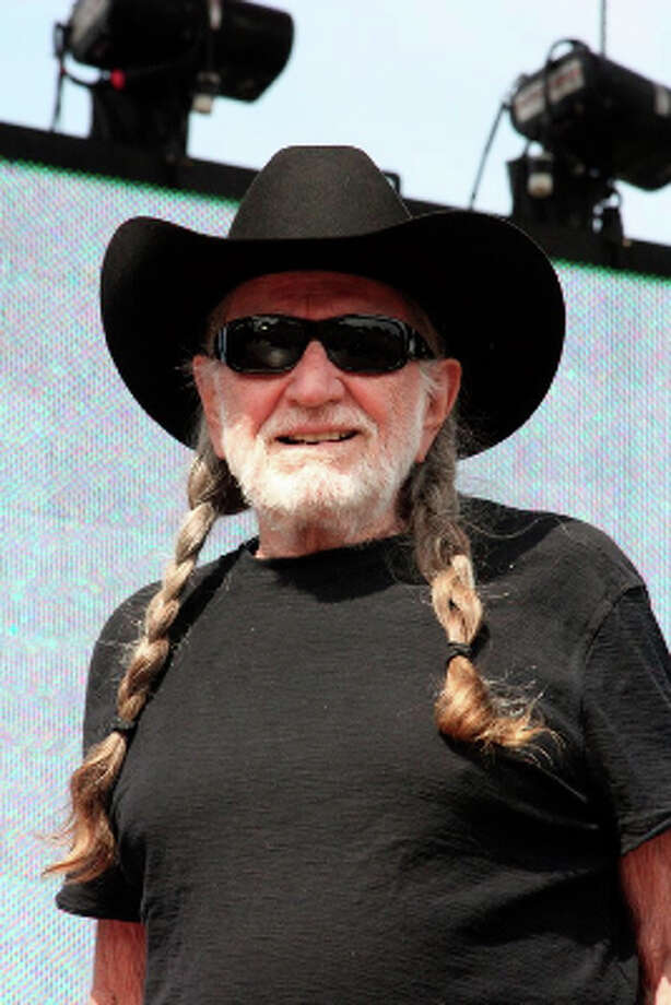 Shades and a large hat are a must. Well done Willie Nelson.Photo by Jordan Graber, Photo: Houston Chronicle