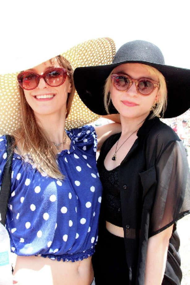 The bigger the hat the better.Kelsey Rogers and Morgynn Hayner. Photo by Jordan Graber. Photo: Houston Chronicle